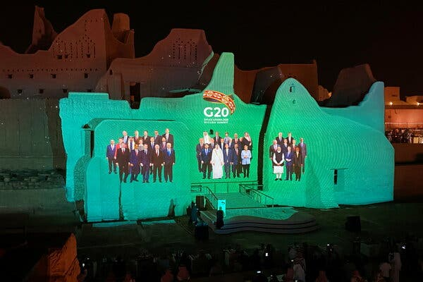 """A digital """"family photo"""" of G20 leaders projected at the Salwa Palace in Diriyah, Saudi Arabia."""