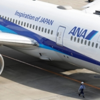 Battered by the COVID-19 pandemic, ANA Holdings Inc. plans to issue new shares following a board meeting as early as next week to raise around ¥200 billion.  | REUTERS