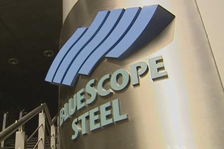 "A metallic sign that reads ""BlueScope Steel""."