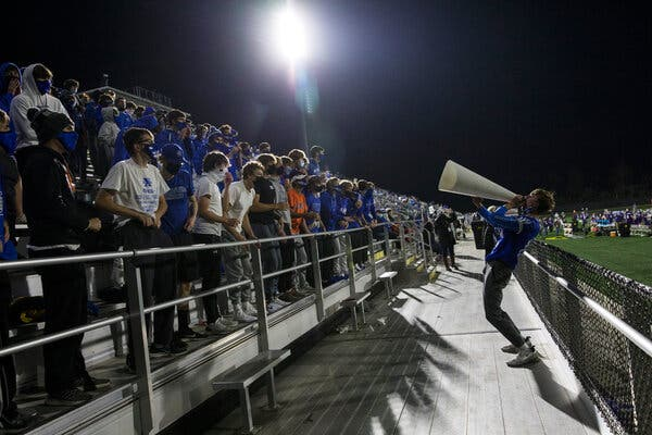 A youth football game in Columbus, Ohio, last week. Gov. Mike DeWine announced a three-week curfew Tuesday, one of many different strategies states are using as the virus spreads rapidly.