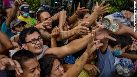 Residents affected by Typhoon Vamco scuffle over relief goods on November 14, 2020 in Rodriguez, Rizal province, Philippines.