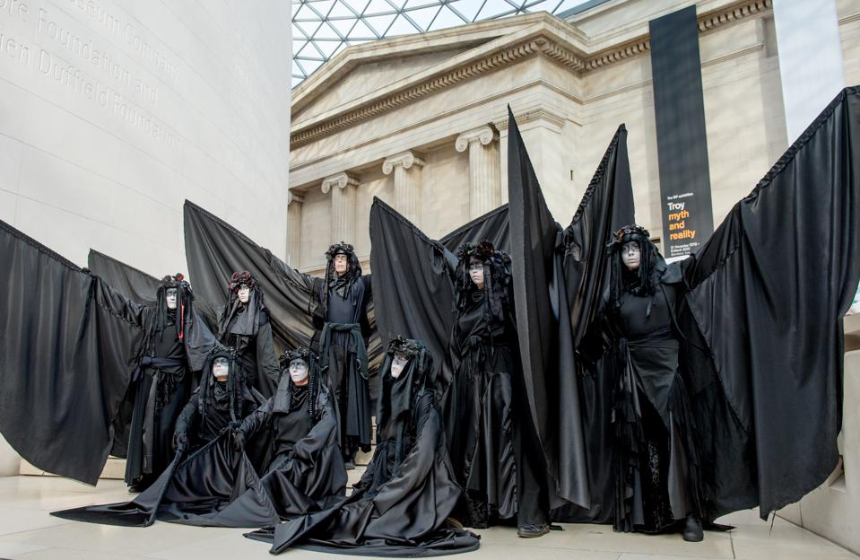Protesters clad in black costumes protest BP oil at the British Museum.