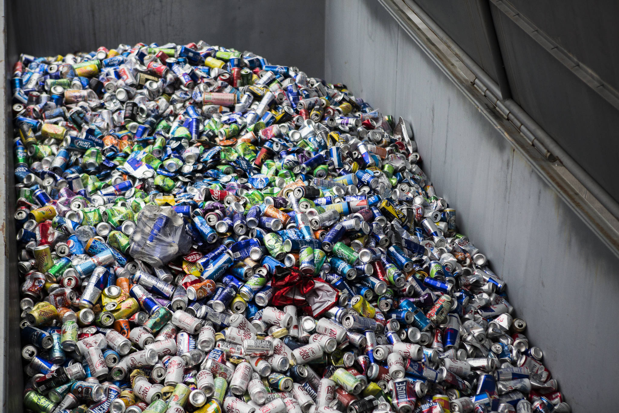 Aluminum cans fill a large recycling container at the Airport Road Recycling & Transfer Station on Nov. 24 in Everett. Photo by Olivia Vanni/The Herald (Everett)