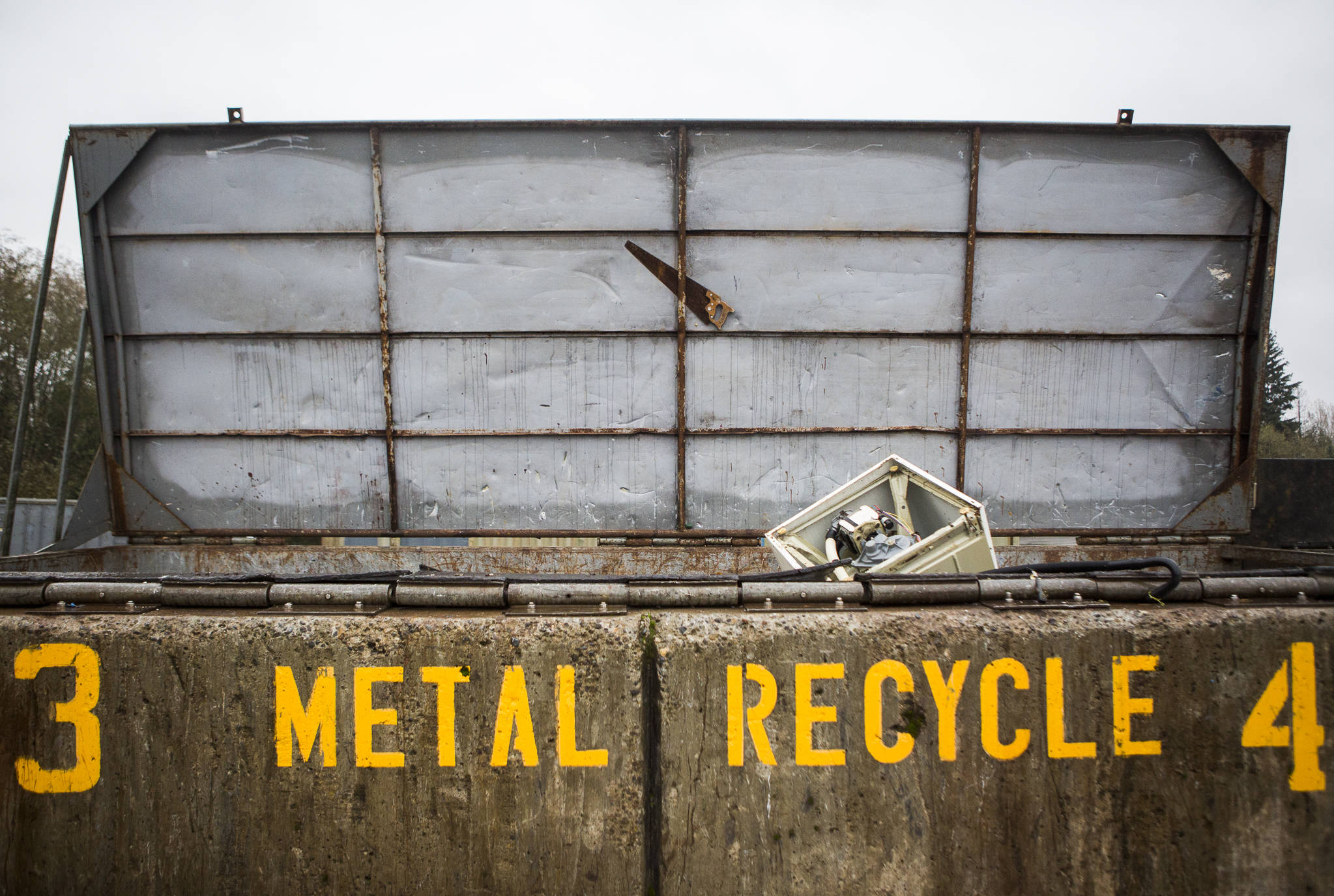 Metal appliances and other metal items fill a recycling container at the Airport Road Recycling & Transfer Station on Nov. 24 in Everett. Photo by Olivia Vanni/The Herald (Everett)