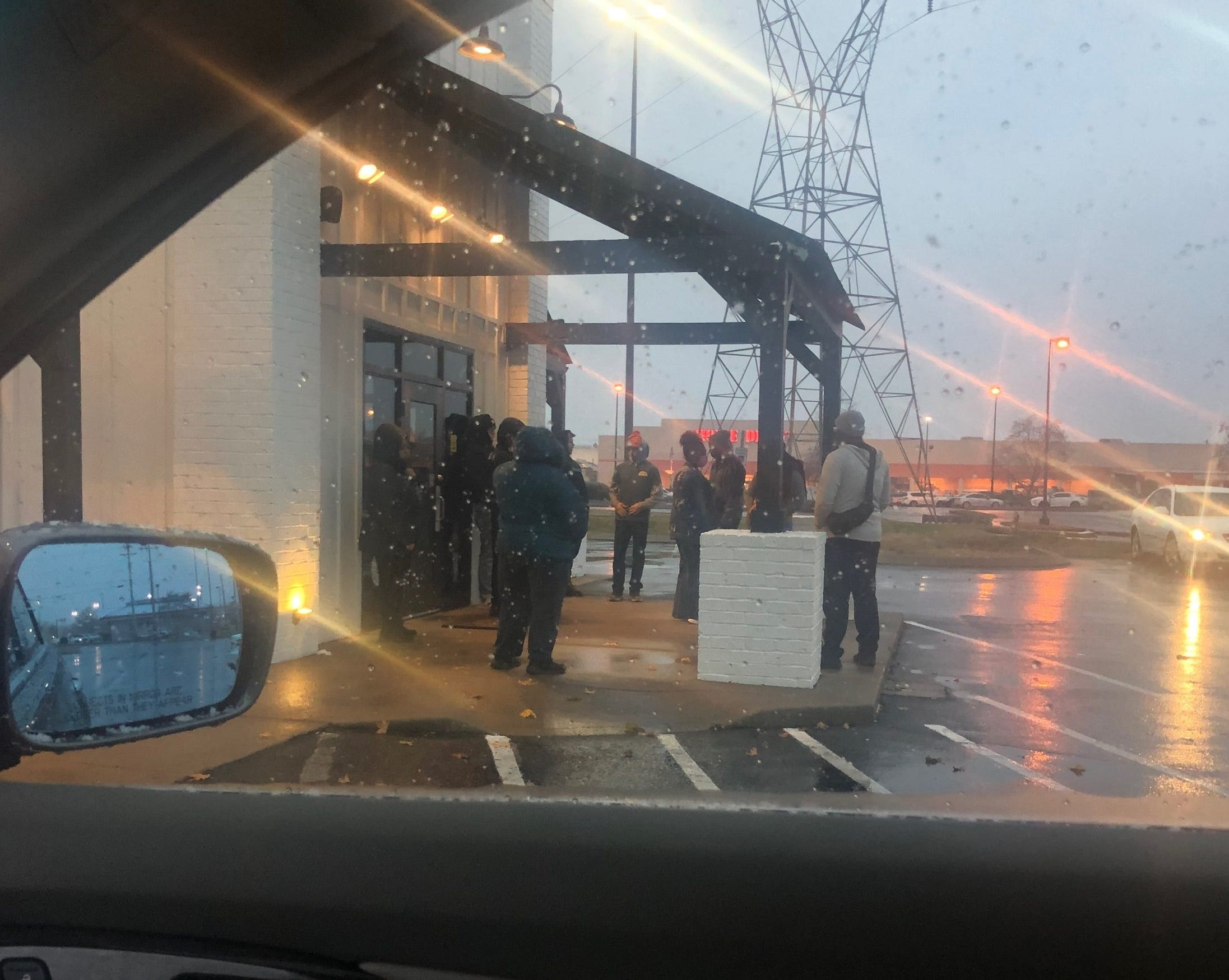 Employees of Pepper+Peach Hot Chicken wait outside the Murfreesboro store on Monday, demanding payment for lost wages.