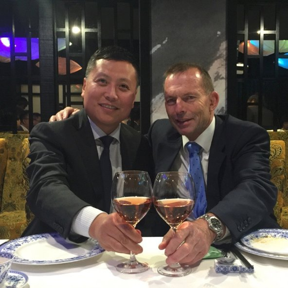 Haha Liu poses for the camera with former prime minister Tony Abbott at an event.