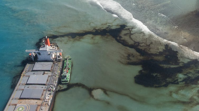 Oil leaks from the MV Wakashio, a Japanese bulk carrier ship that ran aground off the coast of Mauritius in August 2020.