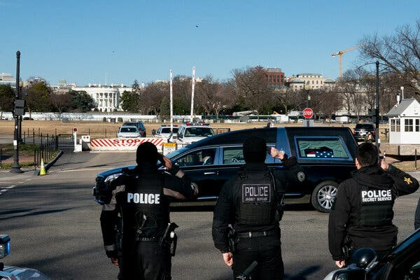 The hearse carrying Brian Sicknick, the U.S. Capitol police officer who died as a result of injuries from an attack on the complex.