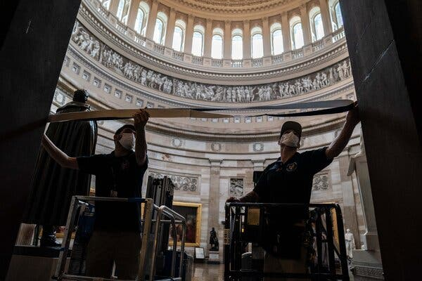 Workers on Friday in the Capitol preparing for President-elect Joseph R. Biden Jr.'s inauguration ceremony.