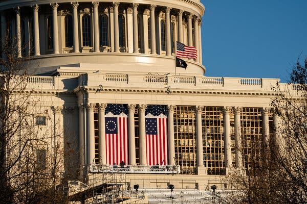 Flags flying over the inauguration stage at the Capitol.