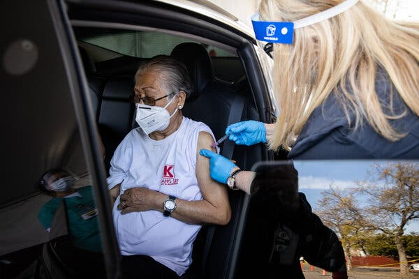 A resident is vaccinated with the covid-19 vaccine on Wednesday in Napa, California.