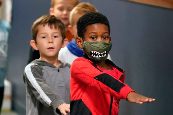 Students in Murphy, Texas, last month. Young children are less likely to be infected by the novel coronavirus, a new study confirmed, but infections become more common in older groups.