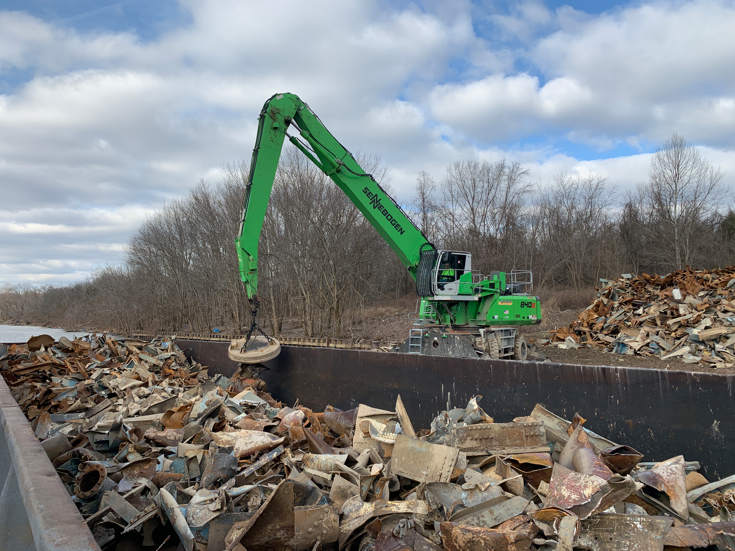 Adamo Group uses its Sennebogen material handlers with a magnet to pull rebar and other ferrous scrap from the piles of rubble, reducing landfilled material and adding an additional revenue stream.
