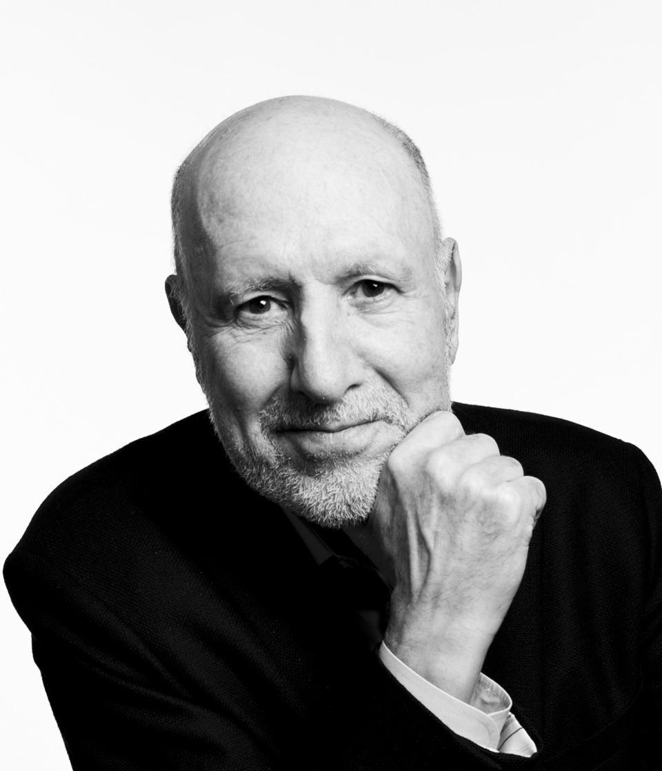 Black and white headshot photo of man