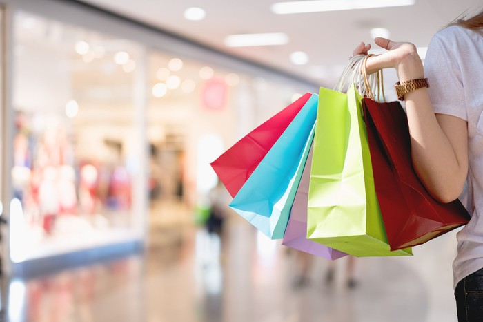 Woman carrying shopping bags.