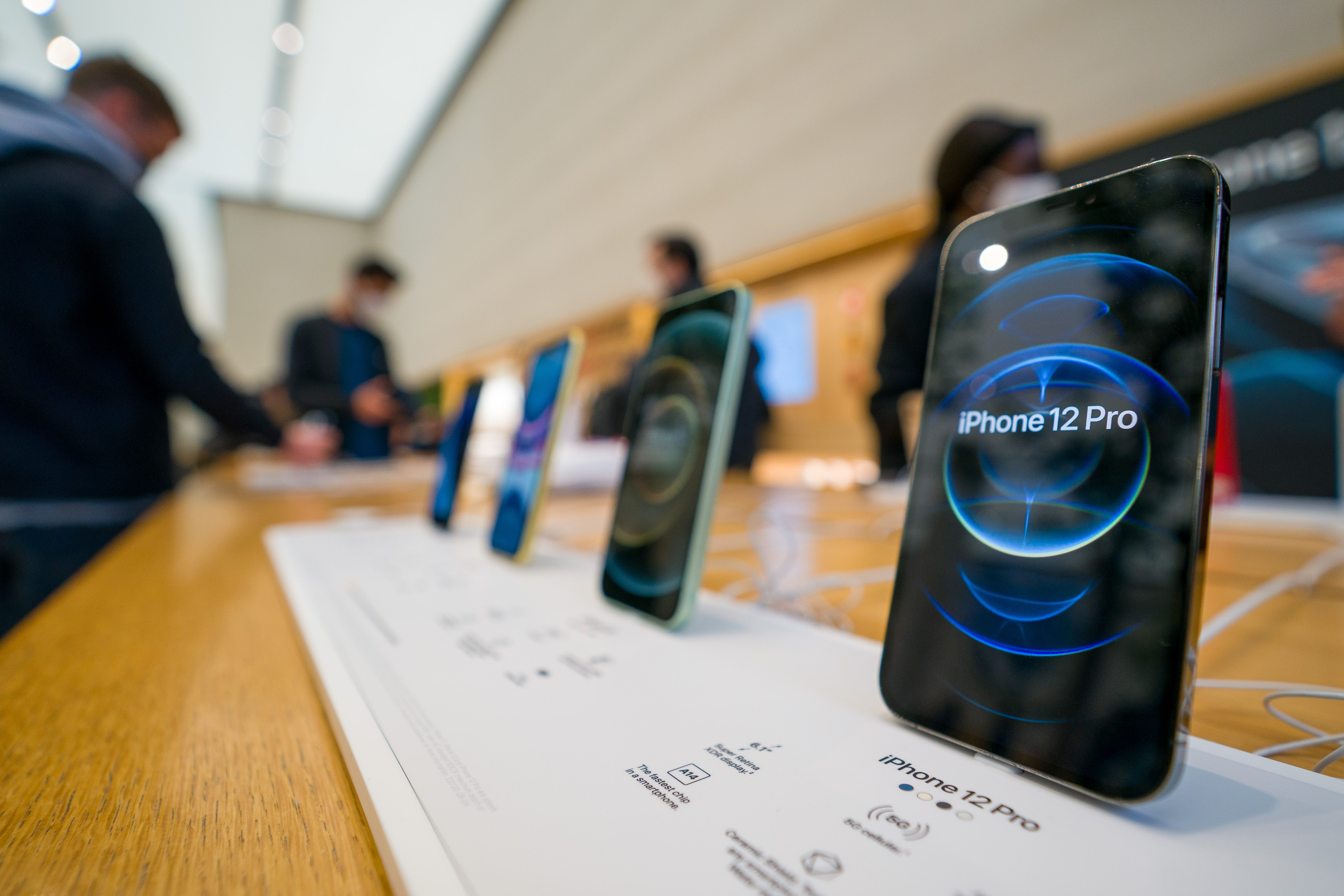 The new iPhone 12 and iPhone 12 Pro on display during launch day on October 23, 2020, in London, England. Apple's latest 5G smartphones go on sale in the UK today. The iPhone 12 Mini and iPhone 12 Pro Max will be available from November 13. (Ming Yeung/Getty Images/TNS)