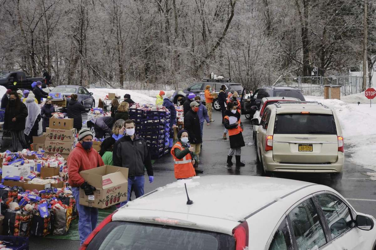 A mass food distribution takes place Friday, Feb. 26, 2021 at Macedonia Baptist Church at 26 Wilson Ave. in Albany. In this photo people drive their vehicles into the area to receive food items during a previous mass food distribution put on by Catholic Charities of the Diocese of Albany, and the Regional Food Bank of Northeastern New York on Tuesday, Feb. 16, 2021, at Watervliet High School in Watervliet, N.Y. (Paul Buckowski/Times Union)
