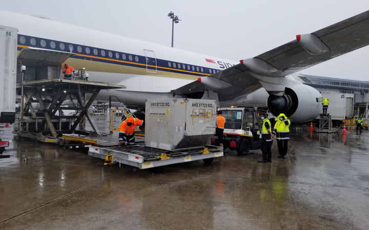 The first batch of the Pfizer Covid-19 vaccine is offloaded after arriving in New Zealand on 15 February