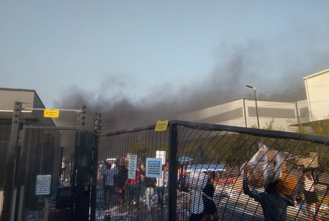 This photo provided by a South Korean resident in South Africa shows LG Electronics Inc.'s factory in Durban on fire on July 12, 2021. (Yonhap)